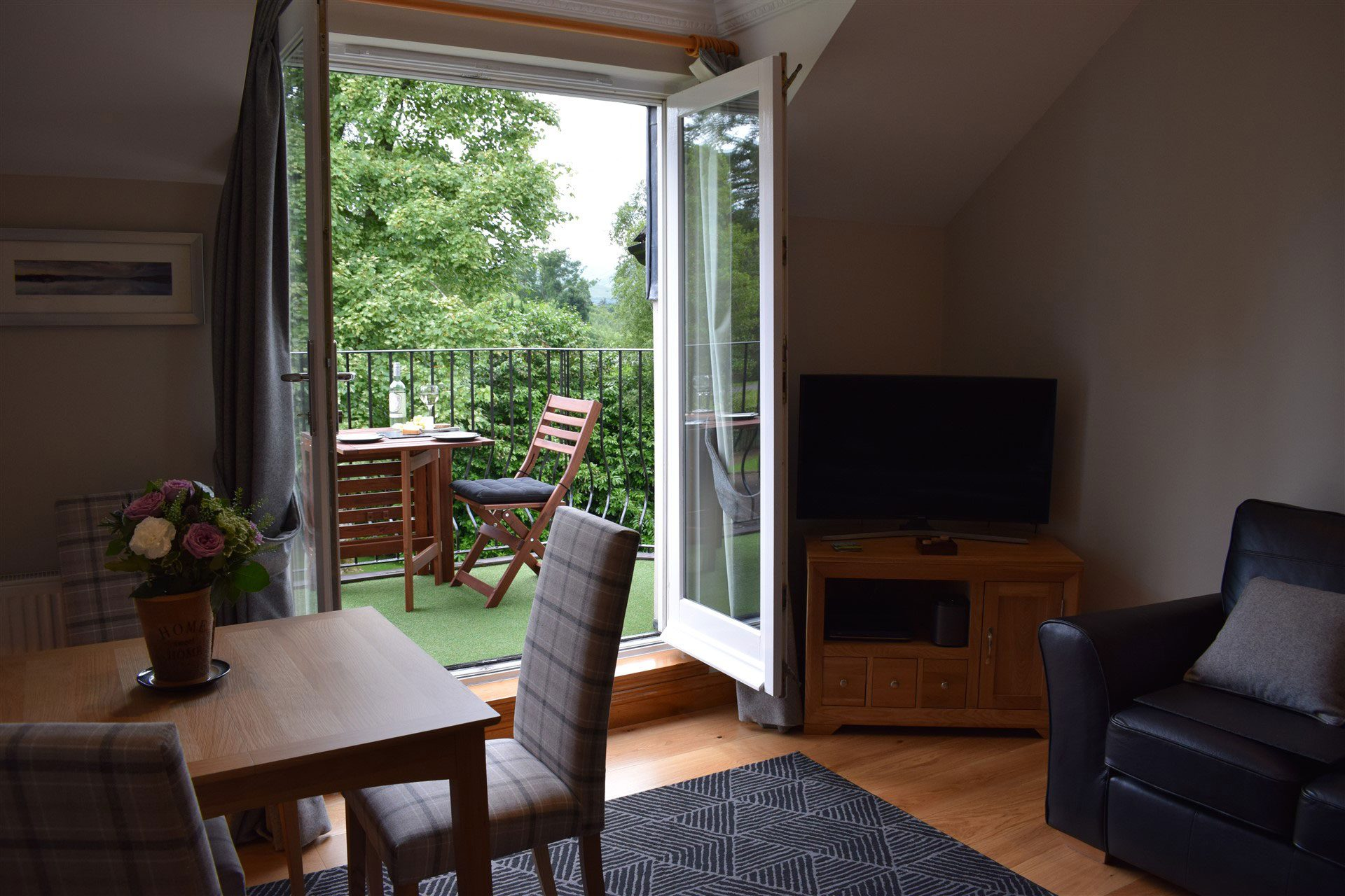 The comfortable lounge at Benoch self-catering apartment leads out through double doors to your own balcony.